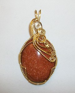Judy Ellis's Gem Profile- Goldstone - , General Education, , Gold Plated wire Goldstone pendant