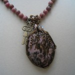 Judy Ellis's Gem Profile- Rhodonite - , General Education, , Rhodonite cabochon pendant