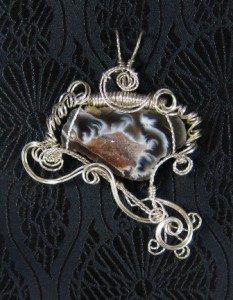 Judy Ellis's Gem Profile- Thundereggs and Mexican Lace Agate - , General Education, , Wire wrapped agate geode slice with silver wire