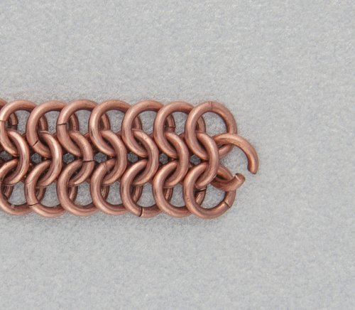 Kylie Jones's Copper Braided Chain Maille Bracelet - , Chain Maille Jewelry, Making Chain, Chain Making , Oxidizing Wire, Oxidizing, Antiquing Wire, Antiquing, Add an open jump ring to the middle.