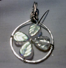 Jill Gentry's Crazy Daisy Pendant - , Contemporary Wire Jewelry, Wire Wrapping, Wrapping, Wire Wrapping Jewelry, Adding petals to the frame.