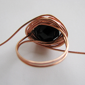 Albina Manning's Quick Wired Bead Ring - , Contemporary Wire Jewelry, Wire Wrapping, Wrapping, Wire Wrapping Jewelry, Ring removed from mandrel with the wrapped wire still on it.