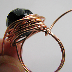 Albina Manning's Quick Wired Bead Ring - , Contemporary Wire Jewelry, Wire Wrapping, Wrapping, Wire Wrapping Jewelry, Tucking each wire in with chain nose pliers.