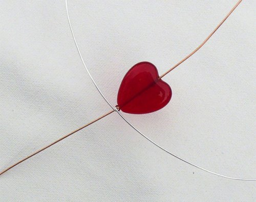 Marty Blu's My Valentine Heart Pendant - , Contemporary Wire Jewelry, Wire Wrapping, Wrapping, Wire Wrapping Jewelry, Heart shaped bead being added to round wire.