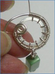 Judy Larson's Snail Trail Spiral Earrings - , Contemporary Wire Jewelry, Wire Wrapping, Wrapping, Wire Wrapping Jewelry, Weaving, Wire Weaving, Weaving Wire, Adding more ring wraps.