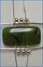 Judy Larson's Double Delight Jade Bracelet - , Contemporary Wire Jewelry, Coiling, Coiling Wire, Wire Coiling, Jump Rings, Jump Ring, Making Jump Rings, Wire Wrapping, Wrapping, Wire Wrapping Jewelry, Adding the wire to other units.