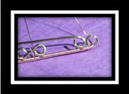 Cynthia Wyatt's Beginners Infinity Bracelet - , Contemporary Wire Jewelry, Coiling, Coiling Wire, Wire Coiling, Lashing, Wire Lashing, Wire Wrapping, Wrapping, Wire Wrapping Jewelry, Finish wrapping the 21 gaige half round wire.