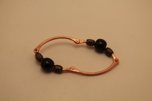 Judy Freyer Thompson's Articulated Copper Wire Bracelet - , Contemporary Wire Jewelry, How To Punch Holes, Hole Punching, Punch A Hole, Riveting, Riveting Techniques, Wire Rivets, finished bracelet