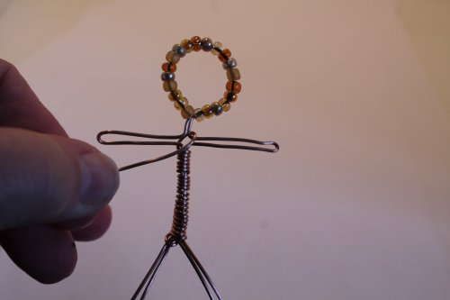 Judy Freyer Thompson's Wire Stick People - , Contemporary Wire Jewelry, Wire Wrapping, Wrapping, Wire Wrapping Jewelry, , criss cross the wire across the shoulders
