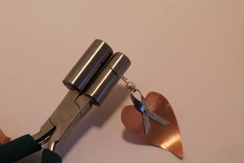Judy Freyer Thompson's Ribbon Heart Earrings - , Contemporary Wire Jewelry, Forging, Forging Jewelry, Jewelry Forging, How To Punch Holes, Hole Punching, Punch A Hole, Riveting, Riveting Techniques, Wire Rivets, Drilling, Drill, make the ear wires