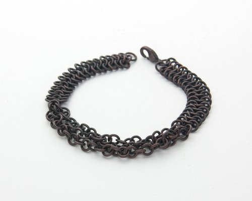 Kylie Jones's Copper Braided Chain Maille Bracelet, Chain Maille Jewelry. Making Chain, Chain Making , Oxidizing Wire, Oxidizing, Antiquing Wire, Antiquing. This bracelet uses the 4 in 1 chain maille weave in a thin band with a decorative plaited chain center.