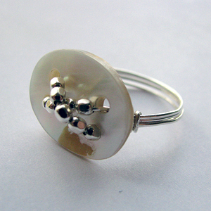 Albina Manning's Button Ring, Contemporary Wire Jewelry. Wire Wrapping, Wrapping, Wire Wrapping Jewelry. How much fun it is to be able to use round craft wire and a few