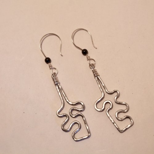 Judy Freyer Thompson's Jigsaw Puzzle Earrings, Contemporary Wire Jewelry. Forging, Forging Jewelry, Jewelry Forging, Texturing, Wire Wrapping, Wrapping, Wire Wrapping Jewelry. I have become somewhat addicted to aluminum wire lately.