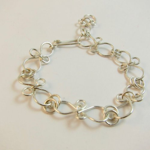 Karen Meador, Ph.D.'s Infinity Link Bracelet, Contemporary Wire Jewelry. Findings, Clasps, Components, Loops, Wire Loop, Wrapped Wire Loop. These simple wire links are super strong because of the rings through the middle.