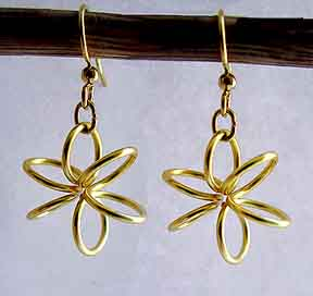 Albina Manning's Spring Flower Earrings, Classic Wire Jewelry. Wire Wrapping, Wrapping, Wire Wrapping Jewelry. This lesson will teach you how to make a spring flower link, from a coiled spring shape.