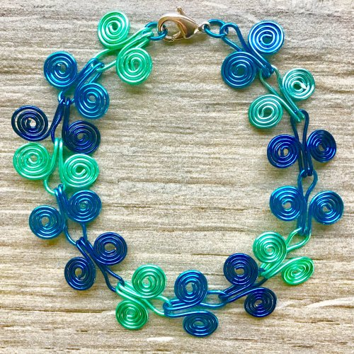 Kristal Wick's Mermaid Spiral Bracelet, Contemporary Wire Jewelry. Spirals, Wire Spiral, Spiral Wire Wrap. Here's a colorful take on a classic design.