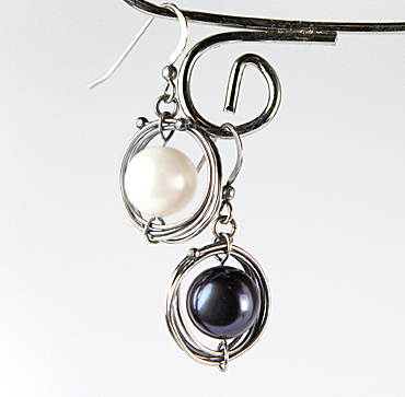 Albina Manning's Orbital Earrings, Contemporary Wire Jewelry. Wire Wrapping, Wrapping, Wire Wrapping Jewelry. A butane torch is the secret ingredient to keep these Orbital Earrings from spinning too far - but if your studio doesn't have a torch, or a heat proof surface to
