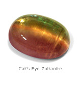 Dale Armstrong's Wrapping Cabochons - , Wire Jewelry Design, Wire Wrapping, Wrapping, Wire Wrapping Jewelry, Weaving, Wire Weaving, Weaving Wire, Design, , Cat's Eye Zultanite gemstone. Photo credit International Colored Gemstone Association.