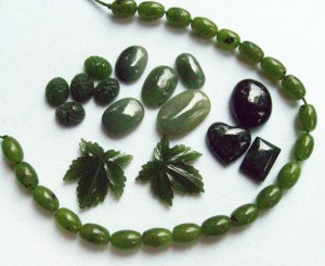 Variety of jadeite carvings and cabochons