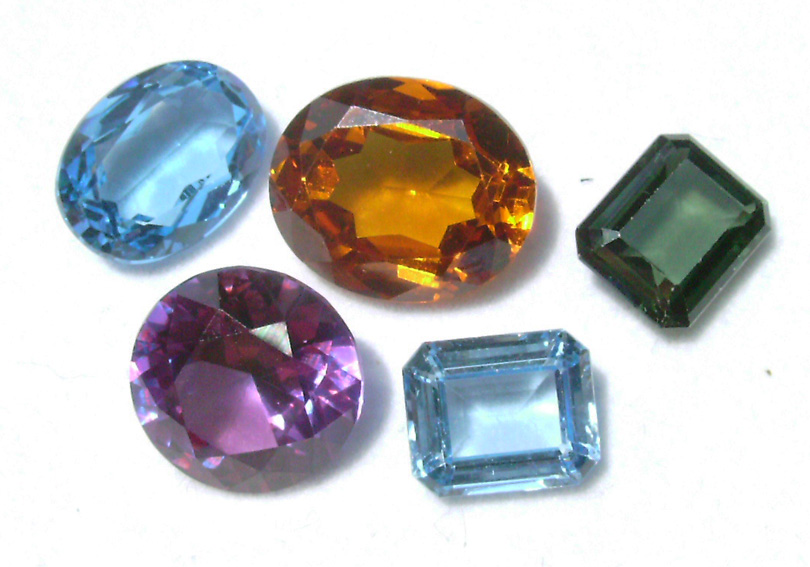 A collection of loose fancy sapphires and rubys, all lab-grown. Private collection, Dale Armstrong