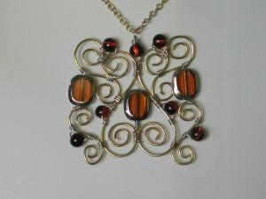 Ironwork pendant