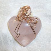 Wire wrapped rose quartz heart