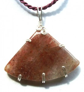Wire wrapped strawberry quartz cabochon