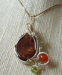 wire wrapped fire agate cabochon by Jane Elizabeth Duke