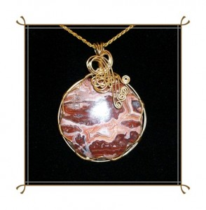 Crazy Lace Agate Cabochon Pendant Wire Wrapped by Joan Madouse