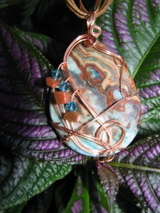 blue crazy lace agate pendant wire wrapped by Linda Pope