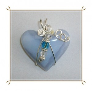 Wire wrapped blue chalcedony heart by Joan Madouse