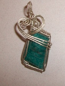 Chrysocolla pendant wrapped in sterling silver wire