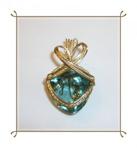 Greenish Blue Aquamarine Trillion (38.42ct) wrapped in 14kt gold filled wire by Joan Madouse