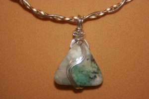 Batya Morris wire wrapped this emerald in matrix cabochon into a reversible pendant.
