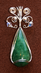 Opaque emerald cabochon wire-wrapped pendant