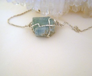 Terri McMahon wire wrapped this 15x13mm piece of raw aquamarine, in 21-gauge square sterling silver wire.