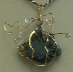 Batya Morris wrapped this rutilated hematite in gold filled and sterling silver wire.