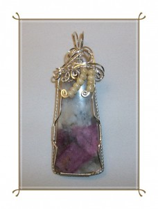 Pink Tourmaline pendant wrapped with silver craft wire by Joan Madouse, with delicate ivory seed pearl accents.