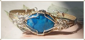 Peggy Marzano wrapped this turquoise howlite cabochon in a bracelet with sterling silver and 14kt gold filled wire.