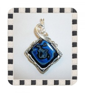 Joan Madouse wrapped this blue Fordite diamond-shaped pendant in sterling silver-filled wire.