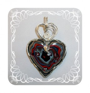 Red Heart Fordite Pendant by Joan Madouse in sterling silver-filled wire