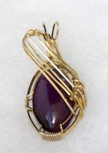 Bonnie DeHart's husband Jerry cabbed this Russian Sugilite, and Bonnie wrapped it into a pendant in 14kt gold-filled wire.