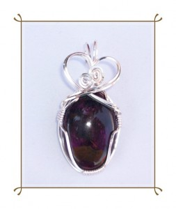 Joan Madouse wrapped this sugilite cabochon with silver-plated wire.