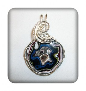 What stone is known as Detroit Agate and isn't an organic material?