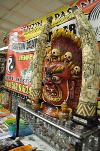 A Tibetan Bead Vendor and his carved scary display at JOGS in Tucson