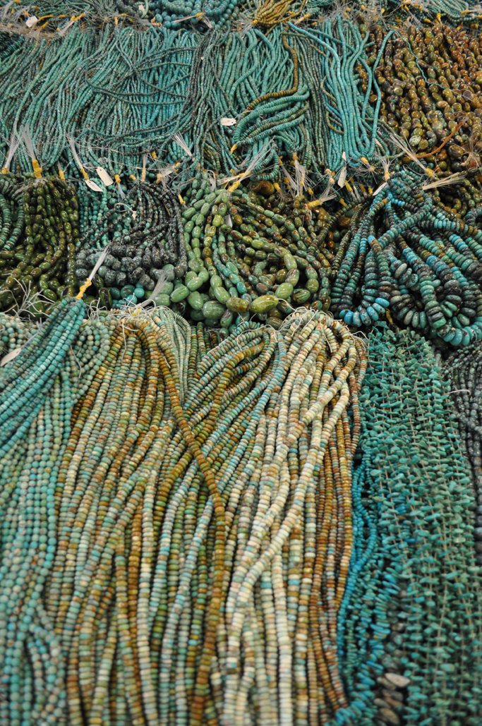Turquoise bead strands drape the tables at JOGS in Tucson