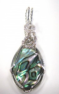 Barbara Rymarquis wire wrapped this abalone shell in sterling silver. This pendant is reversible!