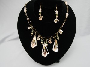 Shell necklace and earrings set by DeLane Cox