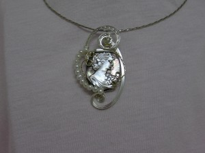 Wire wrapped cameo pendant by Irisha Patterson