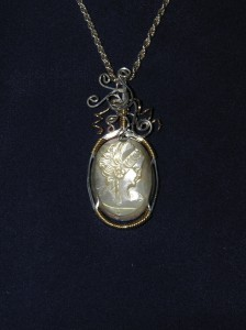 Irisha Patterson created this sterling silver and gold-filled wire frame for this mother of pearl cameo, inspired by Dale Armstrong's book, Wirework
